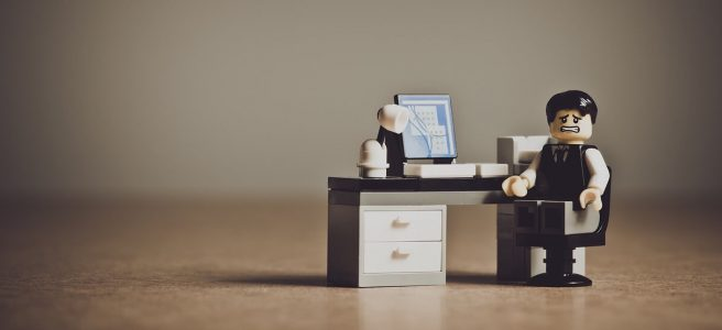 Lego Man Working at Desk